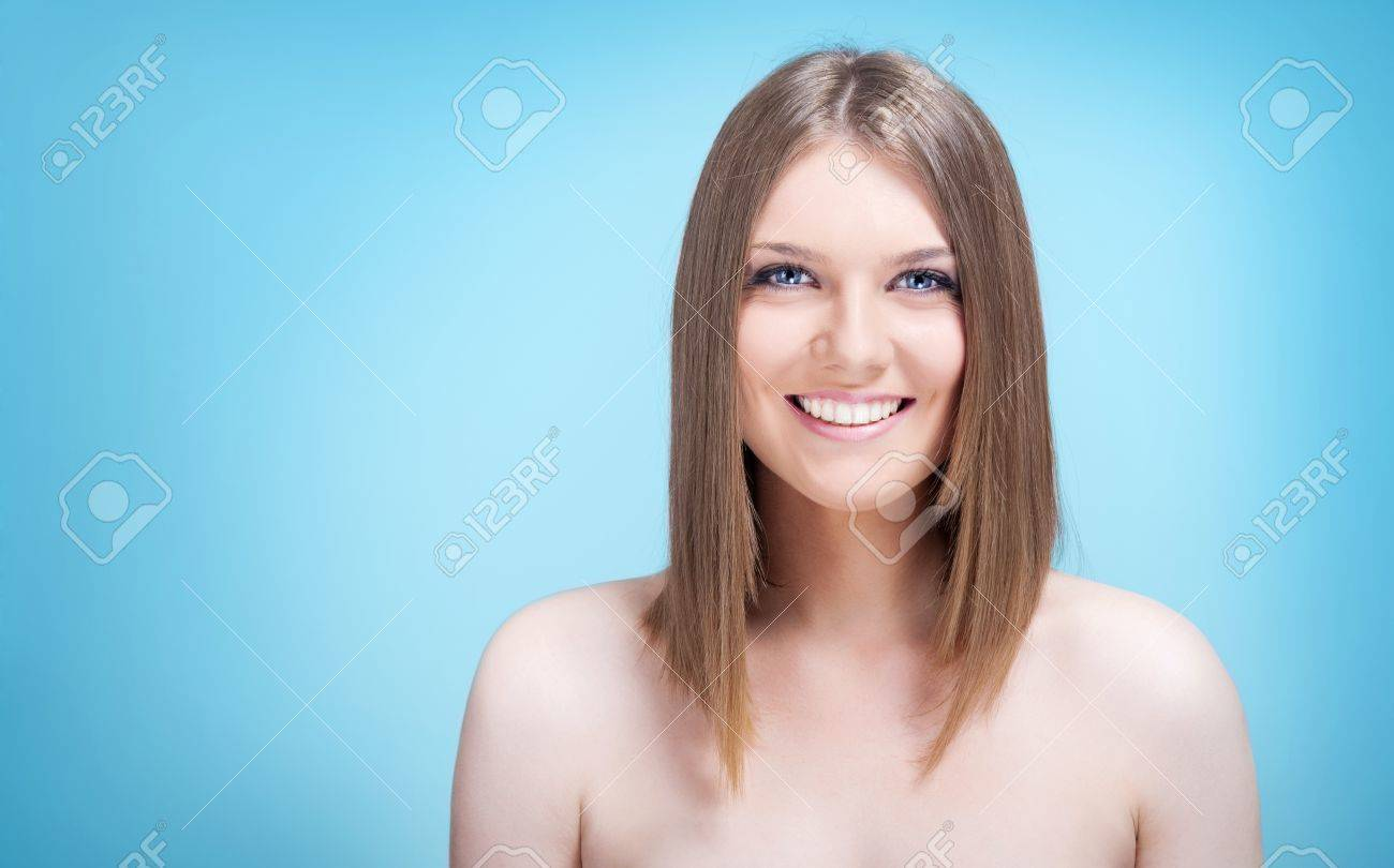 beautiful young woman smiling on pink background Stock Photo - 10275093