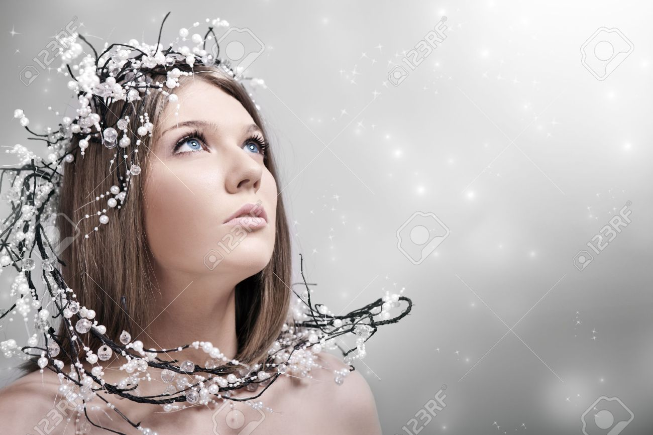 beauty woman with decoration of pearls in hair, looking up Stock Photo - 10275189
