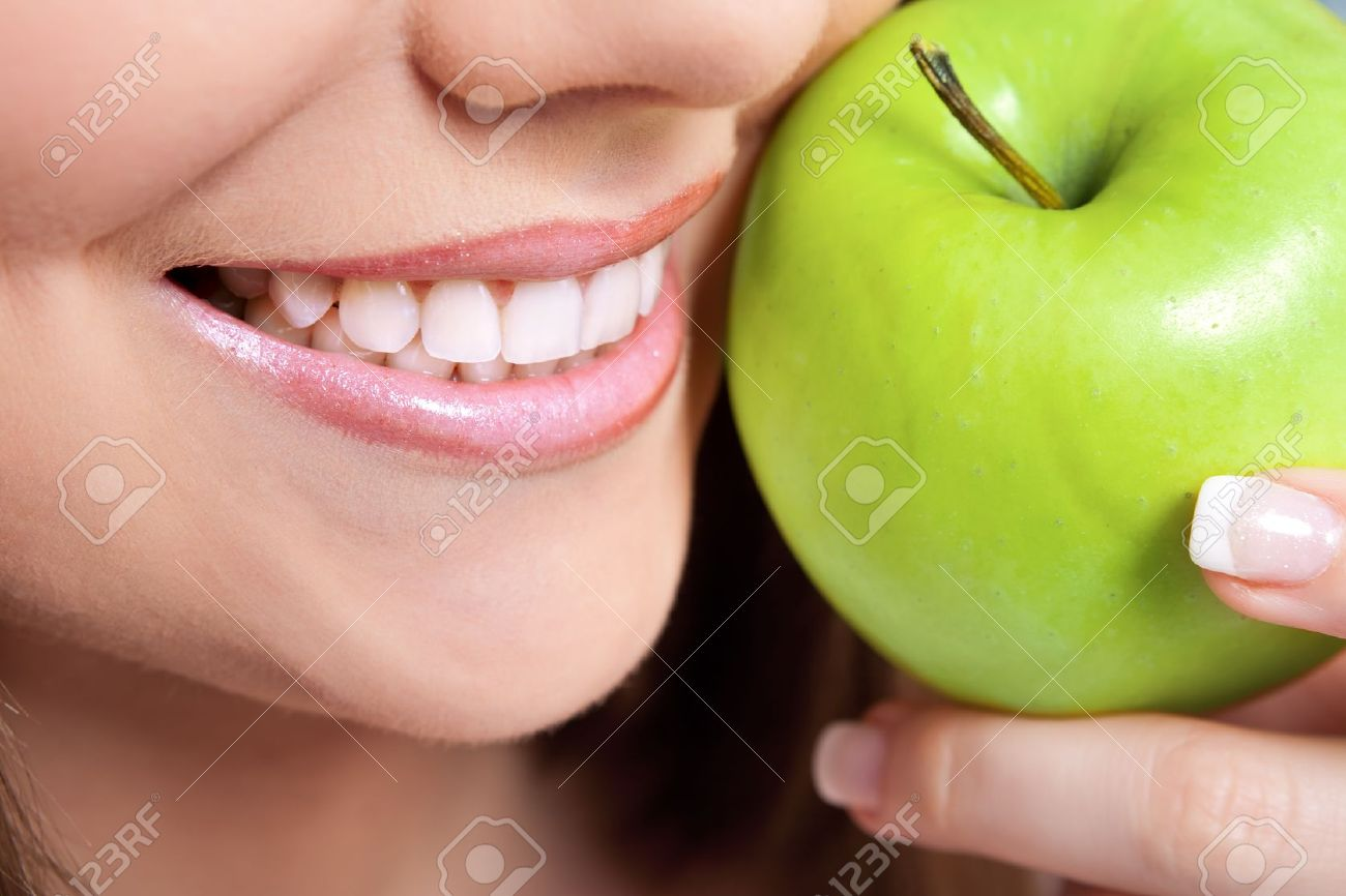 healthy teeth and green apple, close up Stock Photo - 10275109