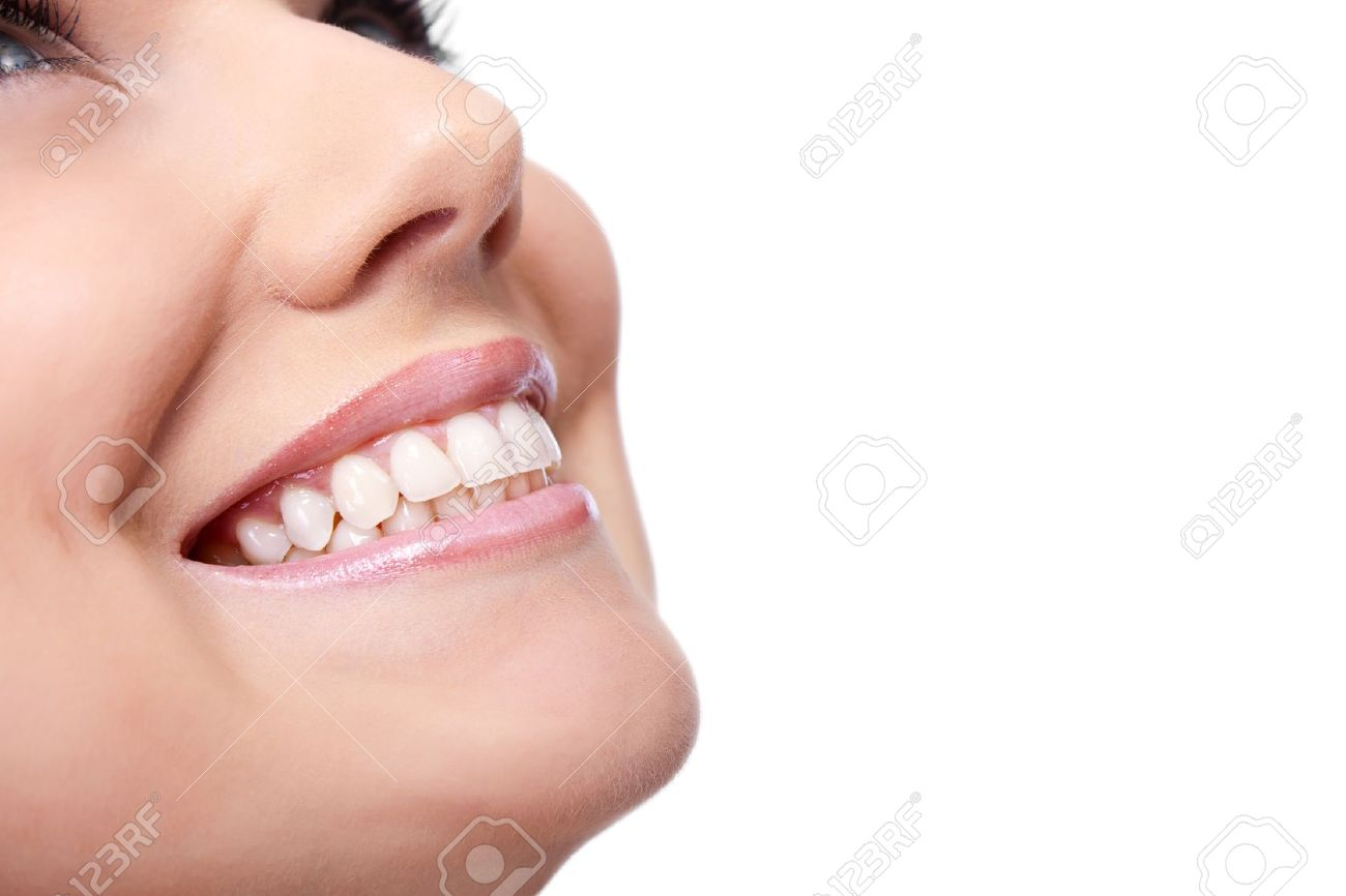 smile of a beautiful young woman , isolated over white background Stock Photo - 10279107