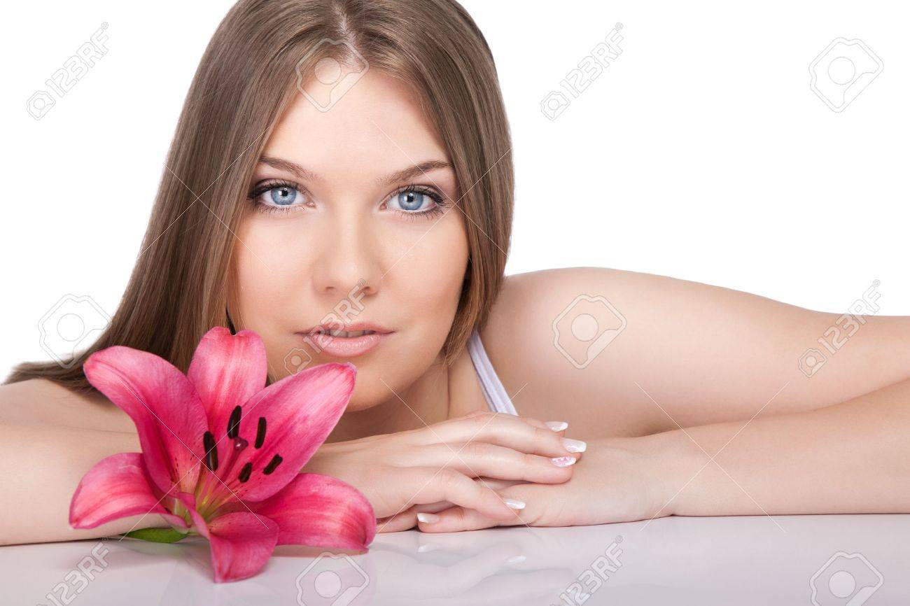 young beautiful woman relaxing with pink  flower at spa isolated on white background Stock Photo - 10275203
