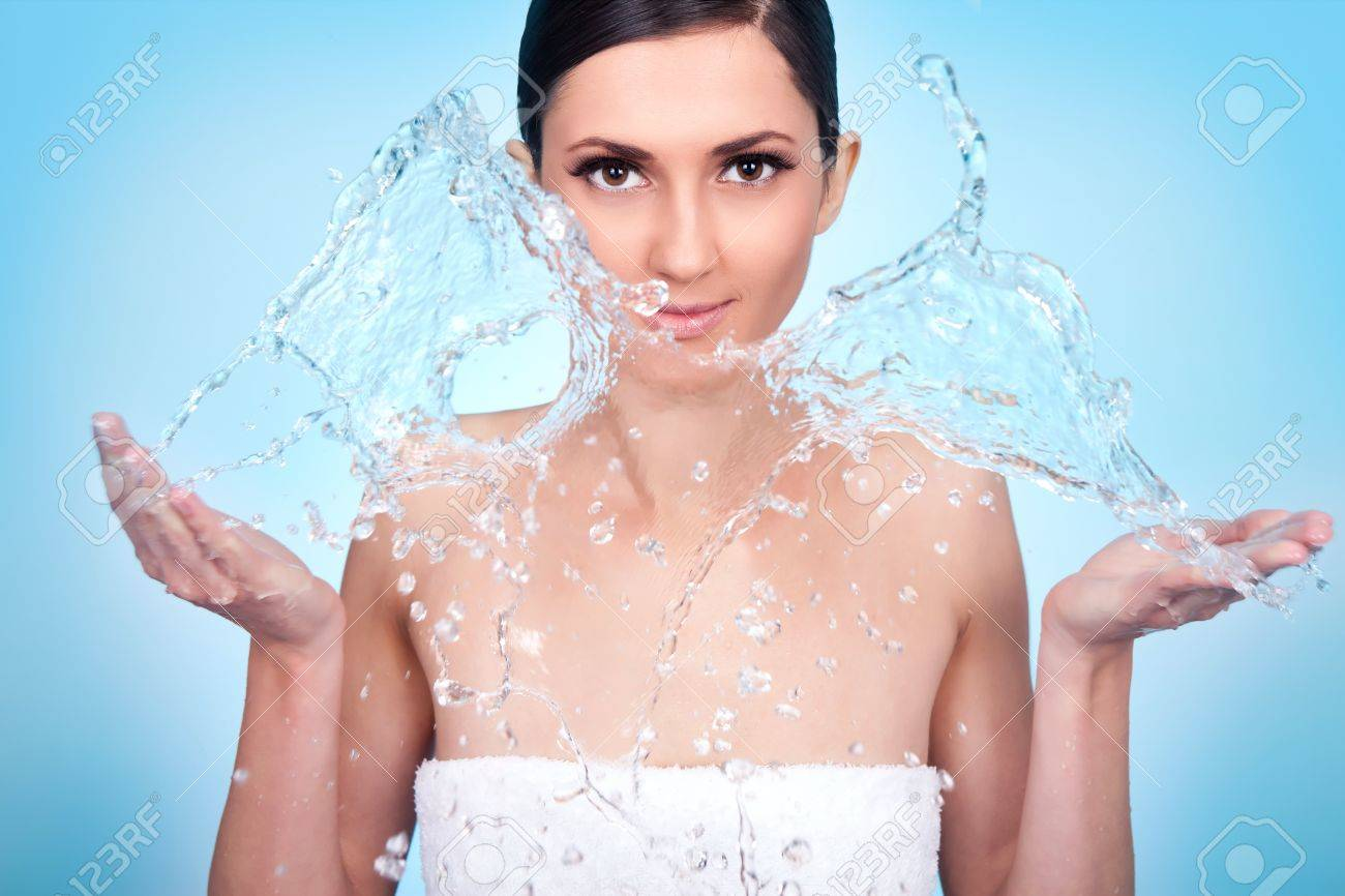 woman washing her face with water Stock Photo - 10278981