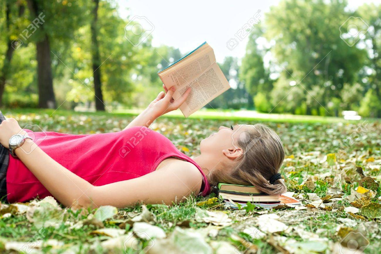 young woman relaxing and reading book - 10687209