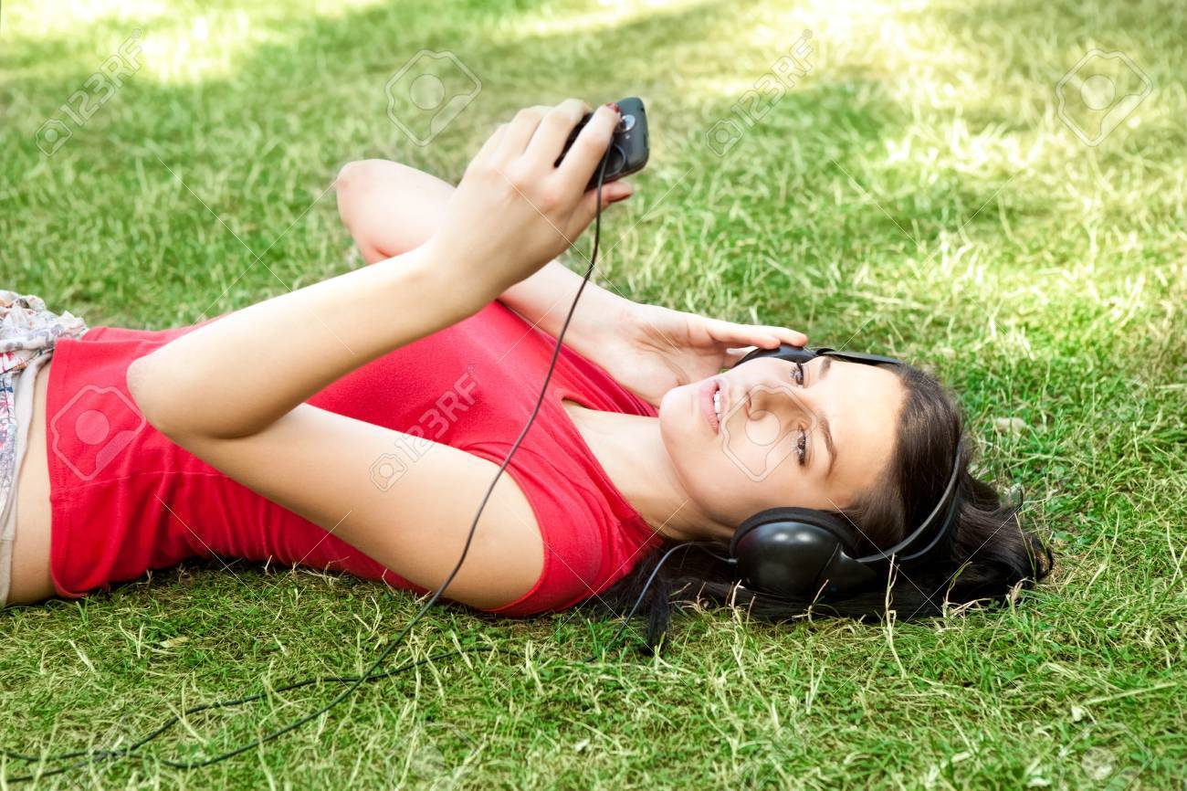 young woman listening music and relaxing Stock Photo - 10693469