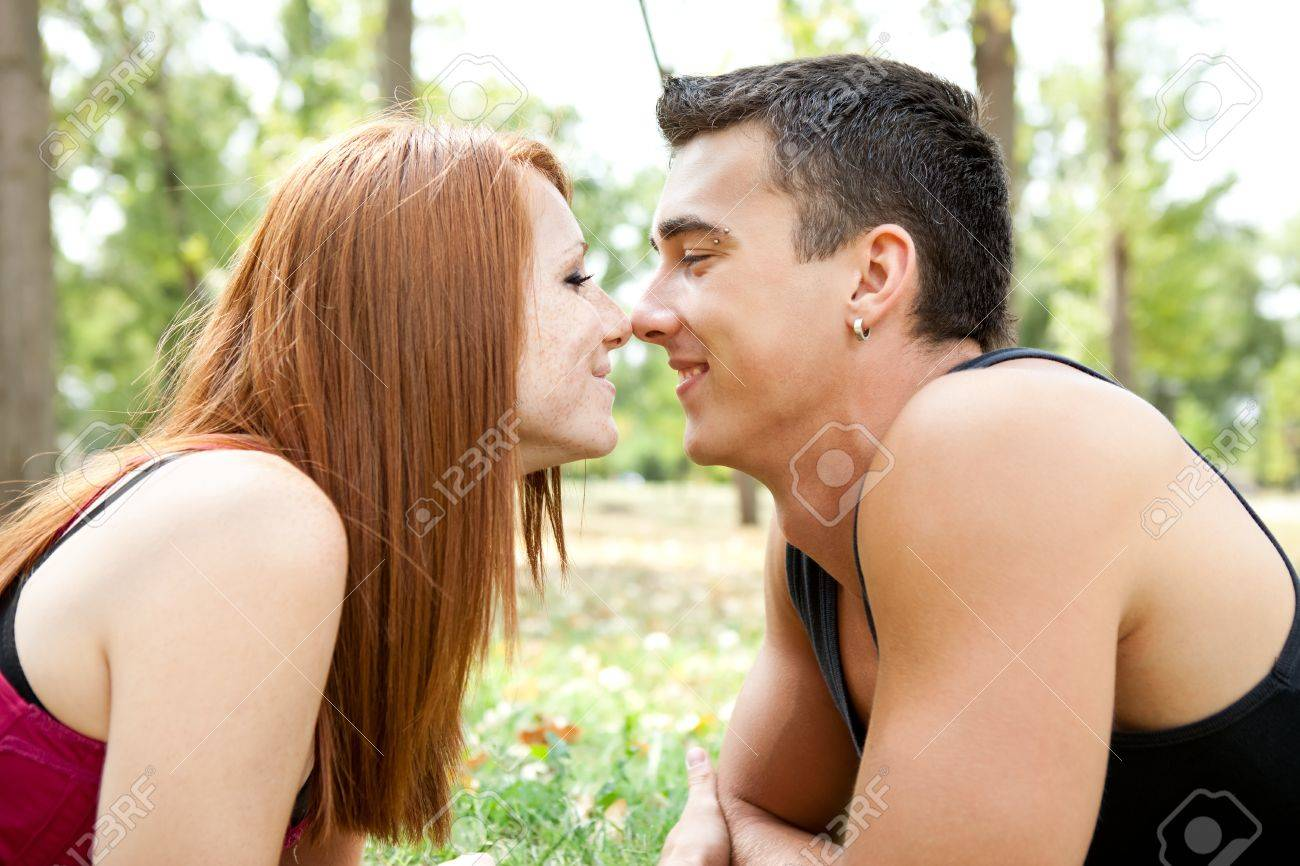 young couple in park having romantic time Stock Photo - 11032588