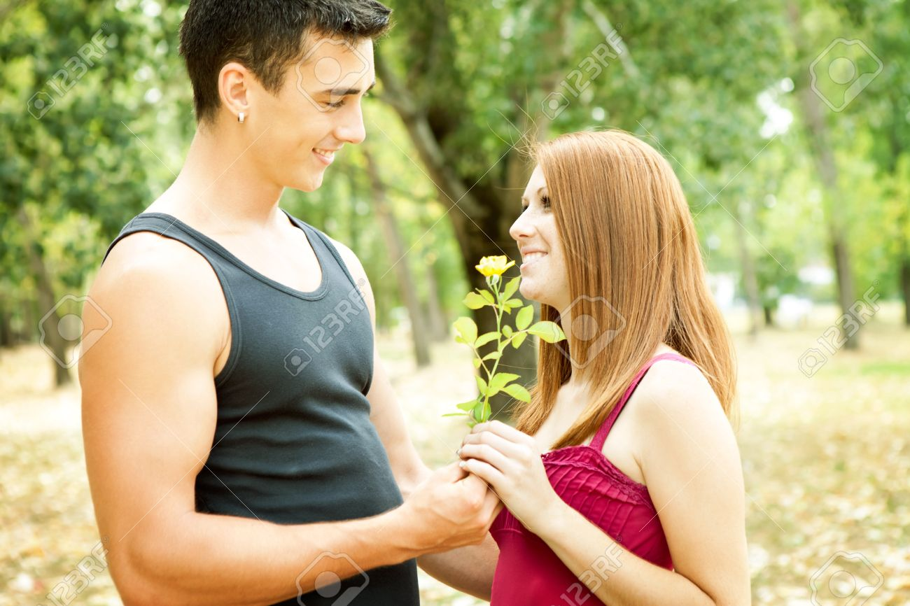 young romantic couple with flower, outdoor - 11032415