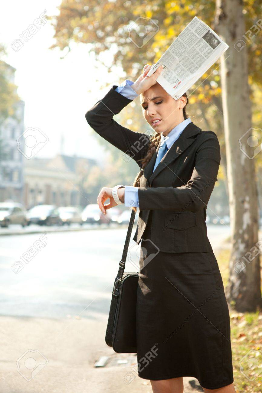 business woman is late for work or a meeting, looking in watch Stock Photo - 11152444