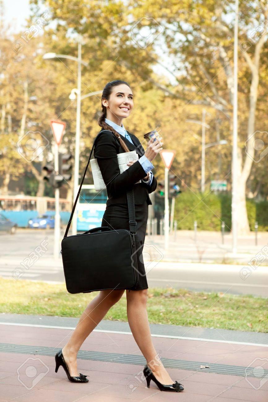 smiling businessw walking on street outdoor stock photo stock photo smiling businessw walking on street outdoor