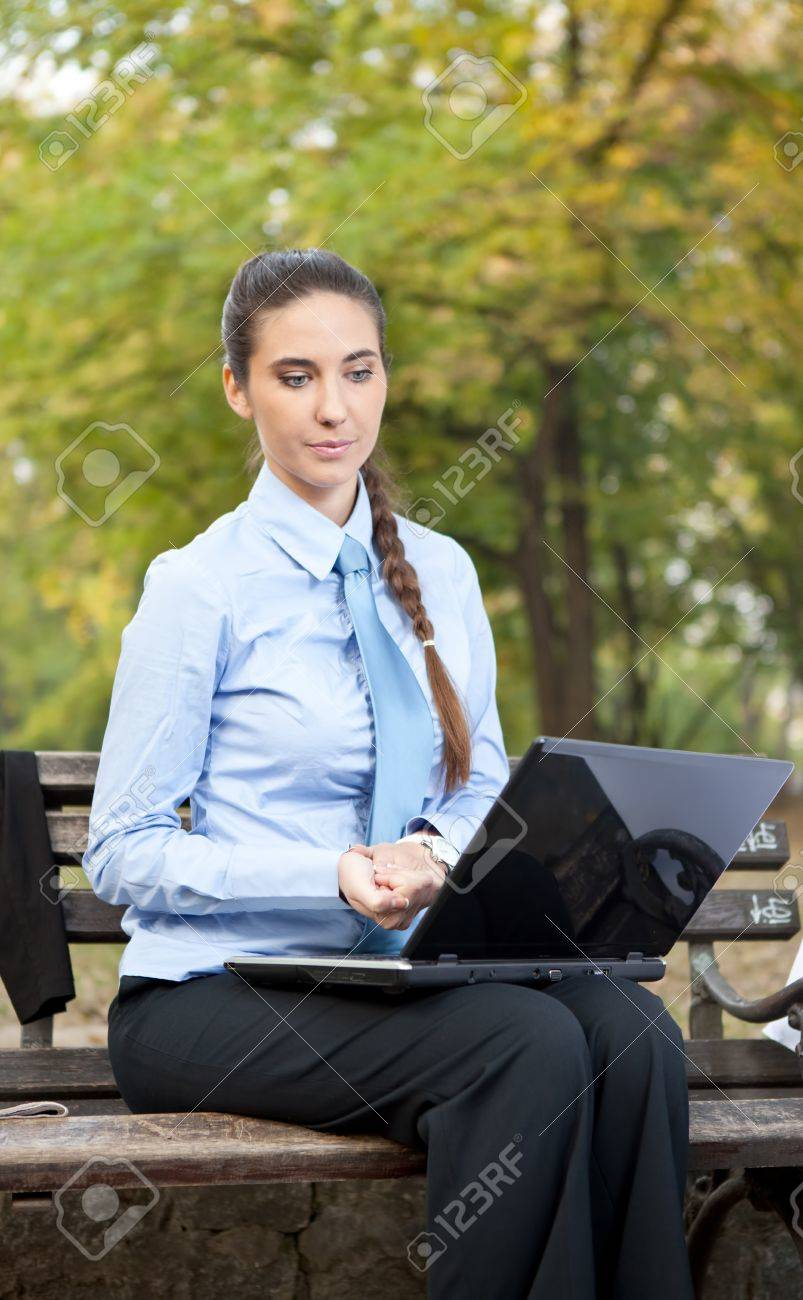 Serious businesswoman looking in lap top, outdoor Stock Photo - 11503906