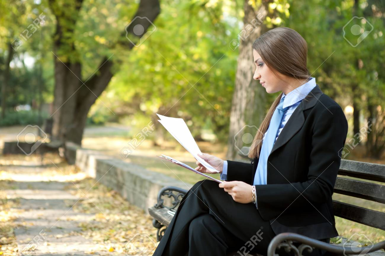 young businesswoman reading document in park Stock Photo - 11503919