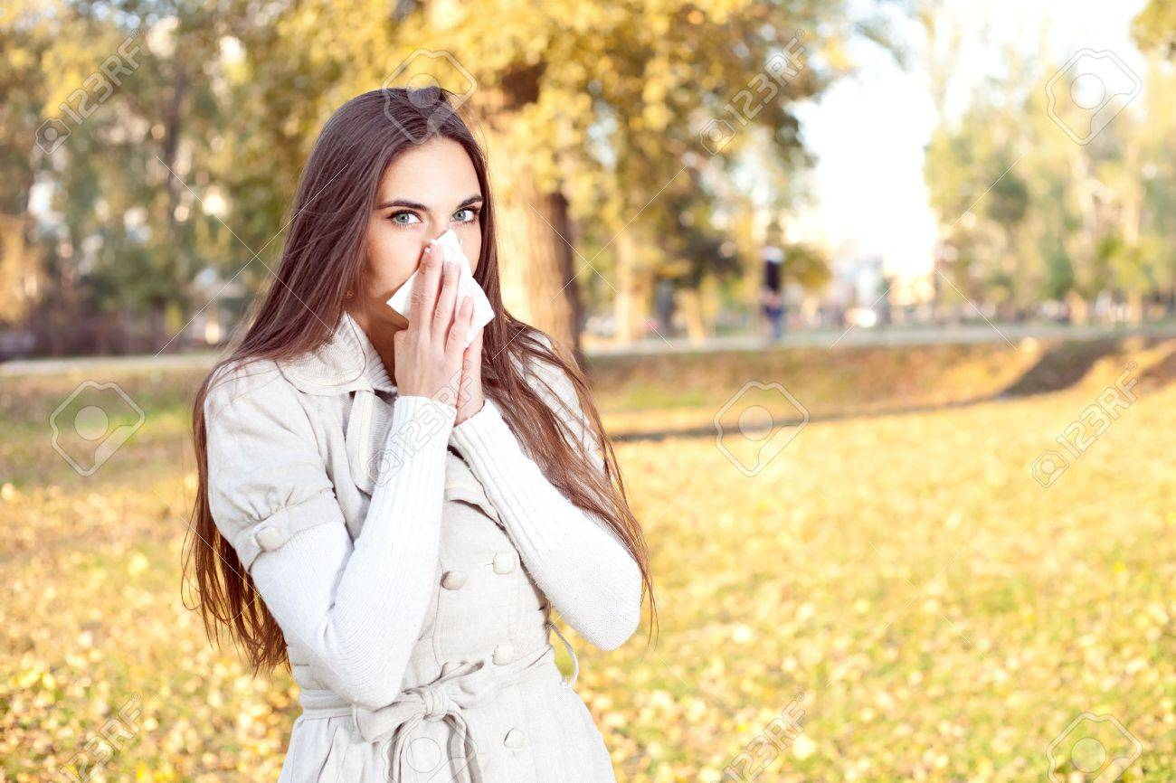 Young girl with tissue having flu or allergy, outdoor Stock Photo - 11516270