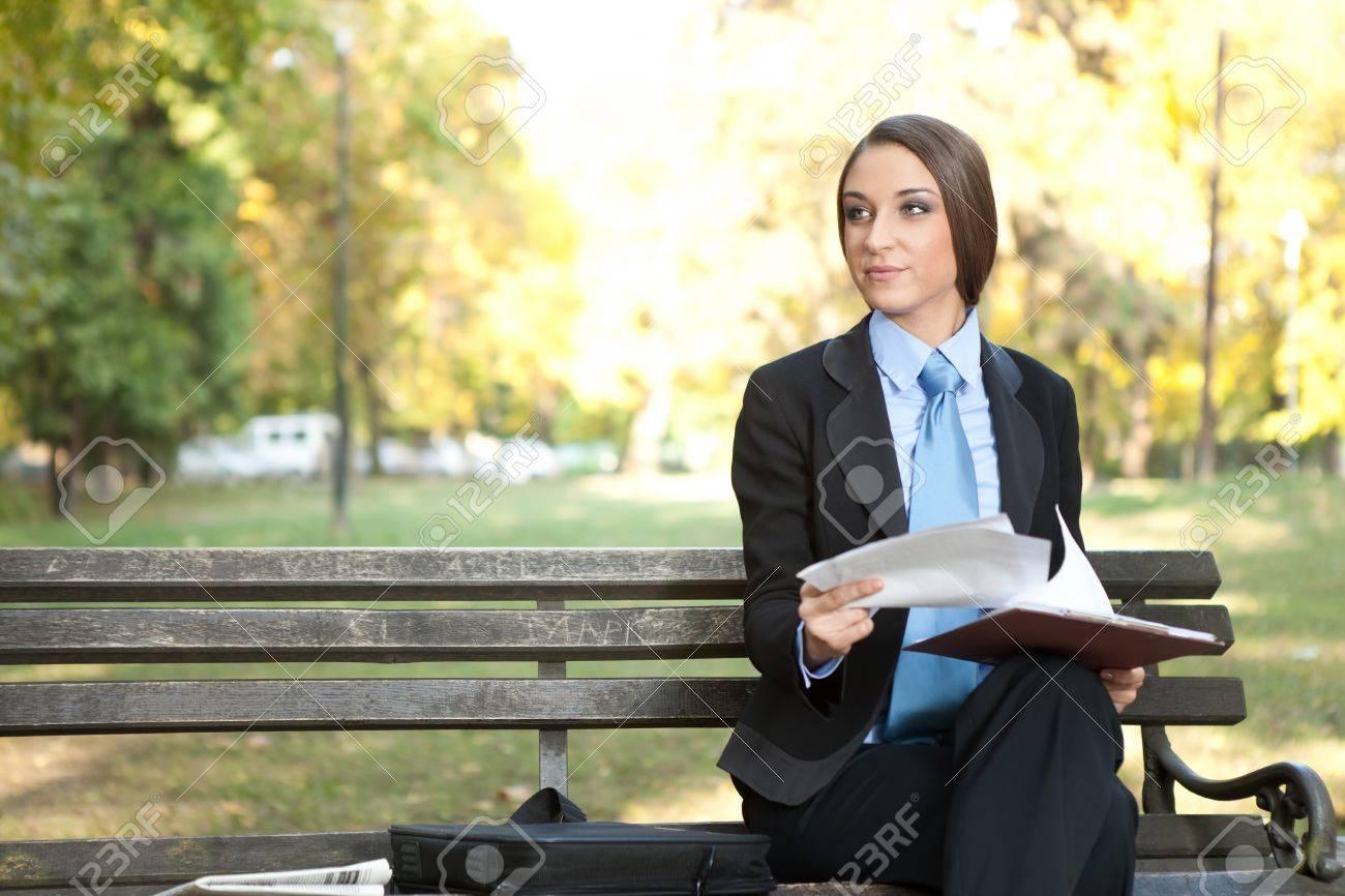 beautiful businesswoman  working with document  on break,  outdoor Stock Photo - 11516266