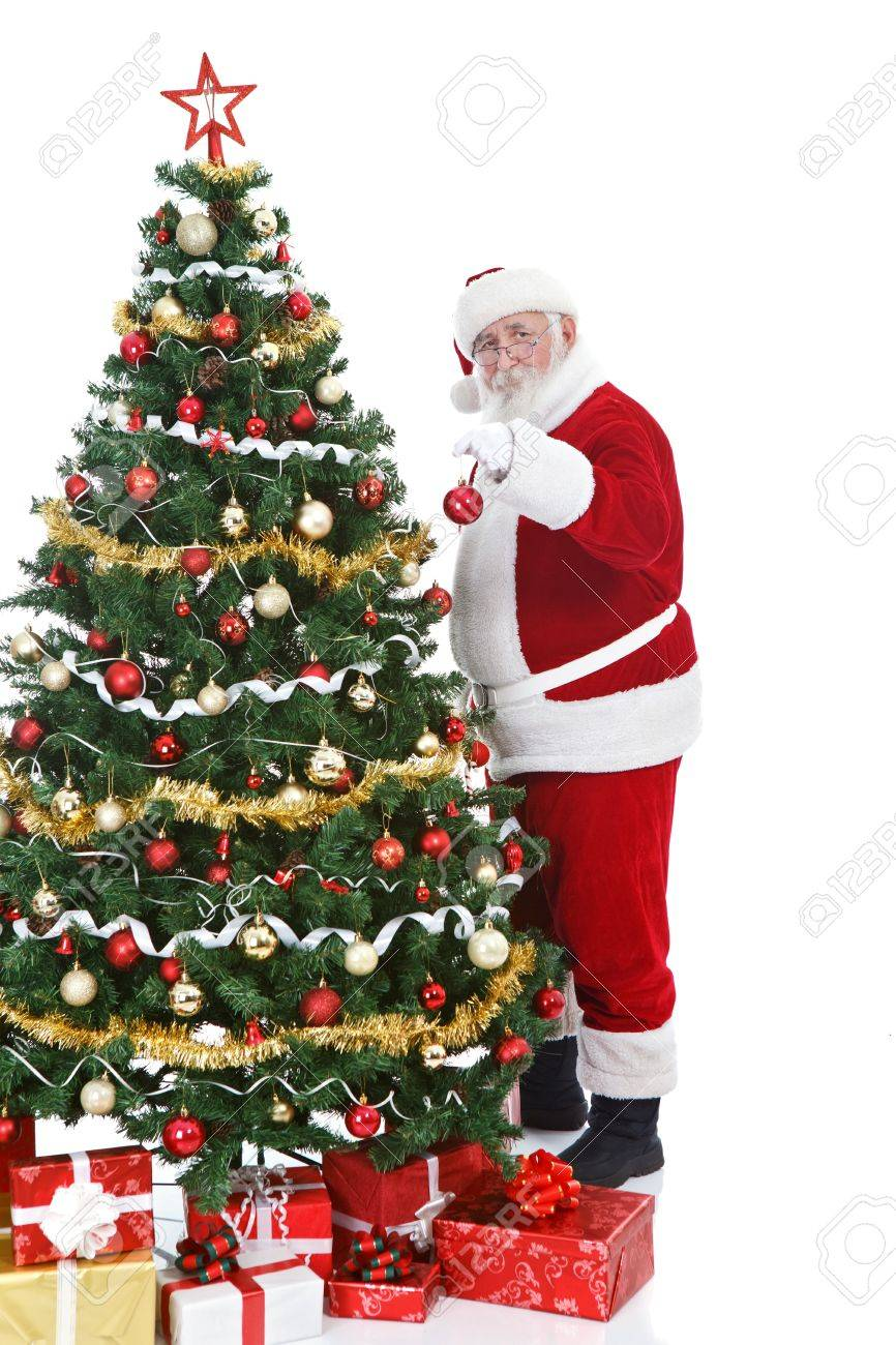 Real Santa Claus Holding Christmas Ball And Decorating Tree Isolated On White Background Stock