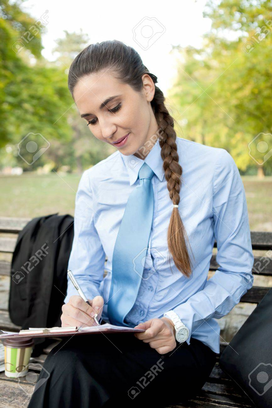 businesswoman making note in park,  overworked Stock Photo - 11859355