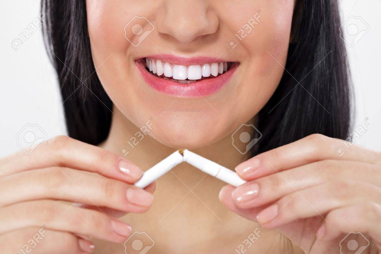 Young woman breaking cigarette, concept-  quitting smoking Stock Photo - 12781423