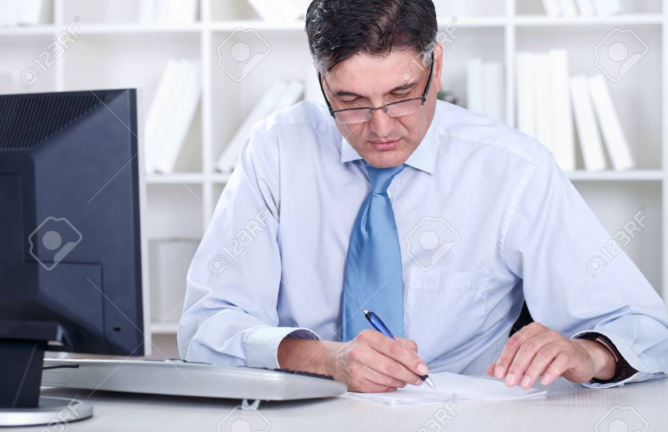Overworked mature businessman working in office Stock Photo - 14332341