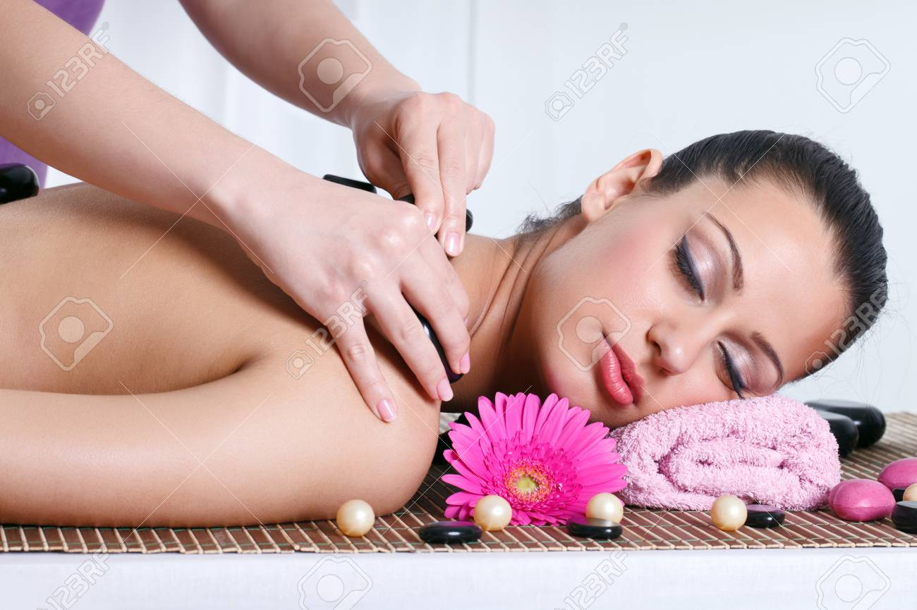 attractive caucasian woman lying down on a massage bed at a spa Stock Photo - 14332473