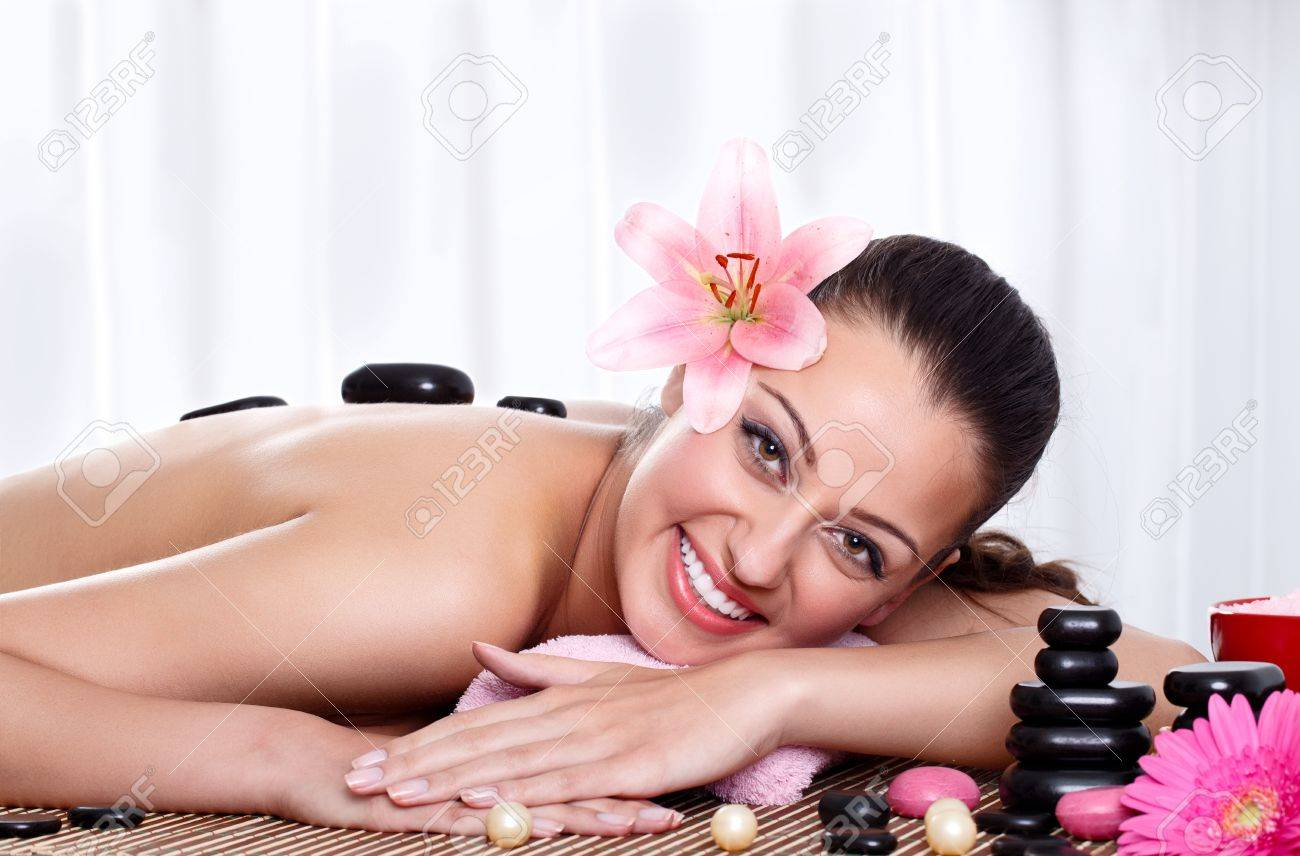 smiling female face - hot stone massage in the day spa - portrait