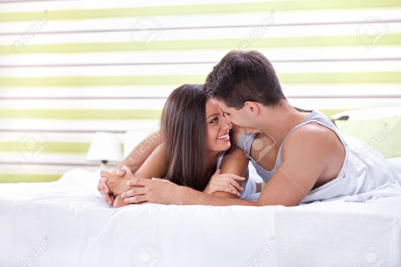 Stock Photo   Young love couple in bed  romantic scene in bedroom. Young Love Couple In Bed  Romantic Scene In Bedroom Stock Photo
