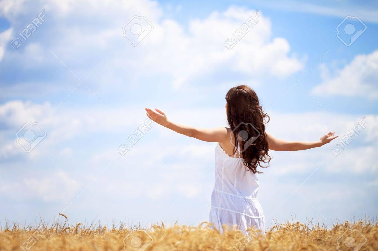 Woman in wheat field enjoying, freedom concept - 15074981
