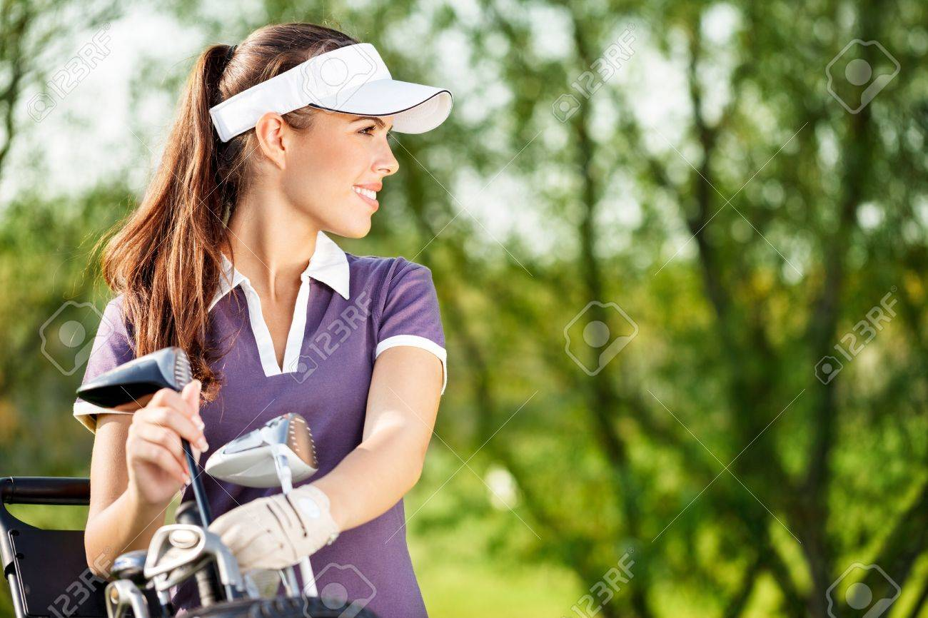 Gorgeous golfer lady with golf equipment Stock Photo - 16217392