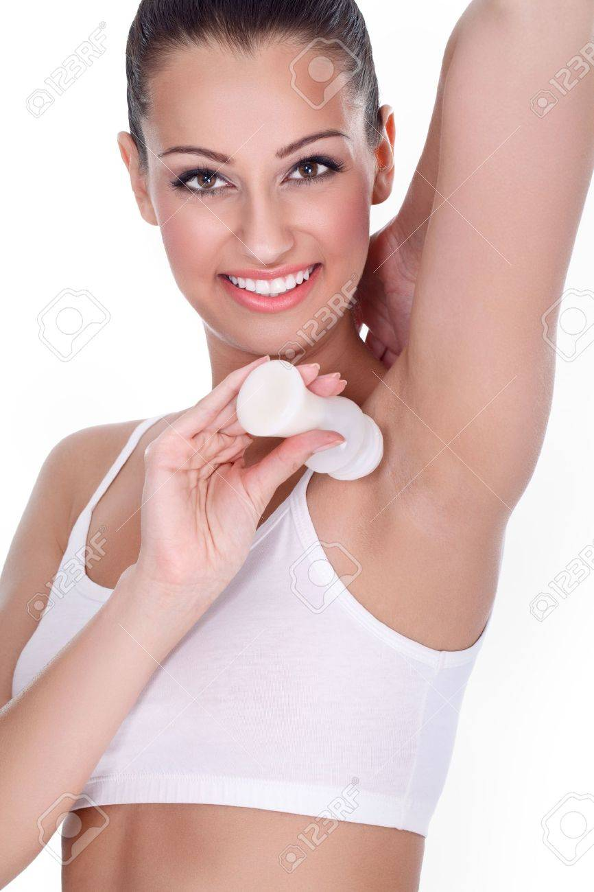 Young smiling woman applying anti perspirant Stock Photo - 16860977