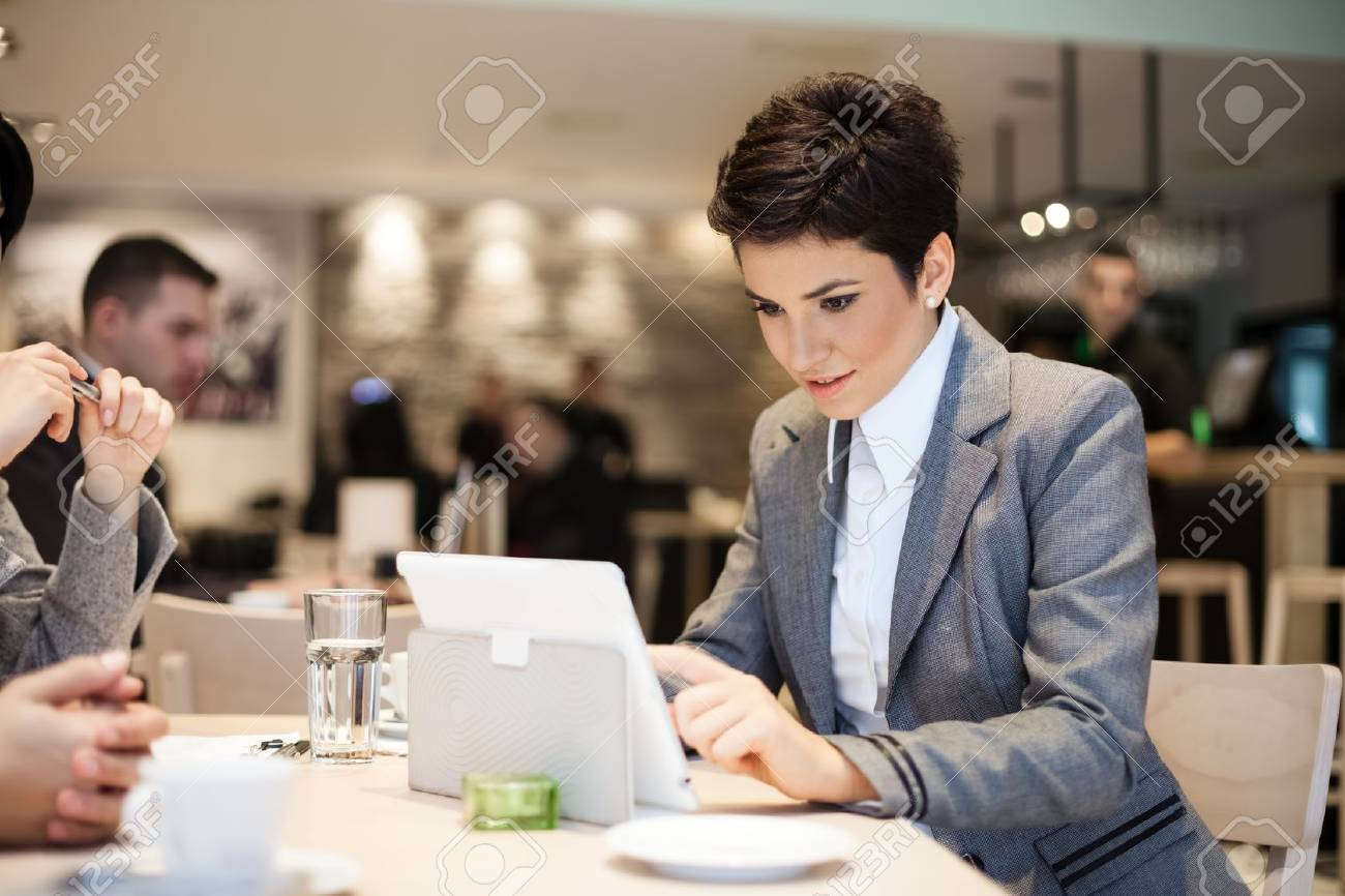 Businesswoman checking her work Stock Photo - 16860927