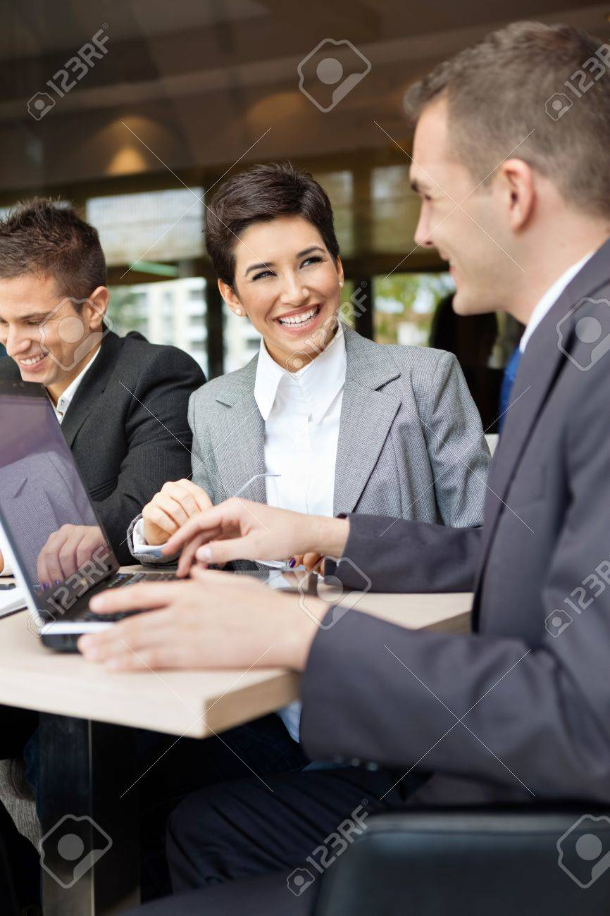 Happy business people on meeting Stock Photo - 17821781