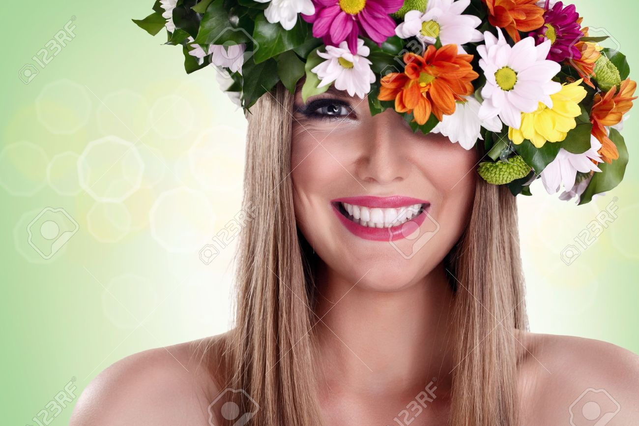 Young beautiful woman with flower wreath and great smile stock photo stock photo young beautiful woman with flower wreath and great smile izmirmasajfo Image collections