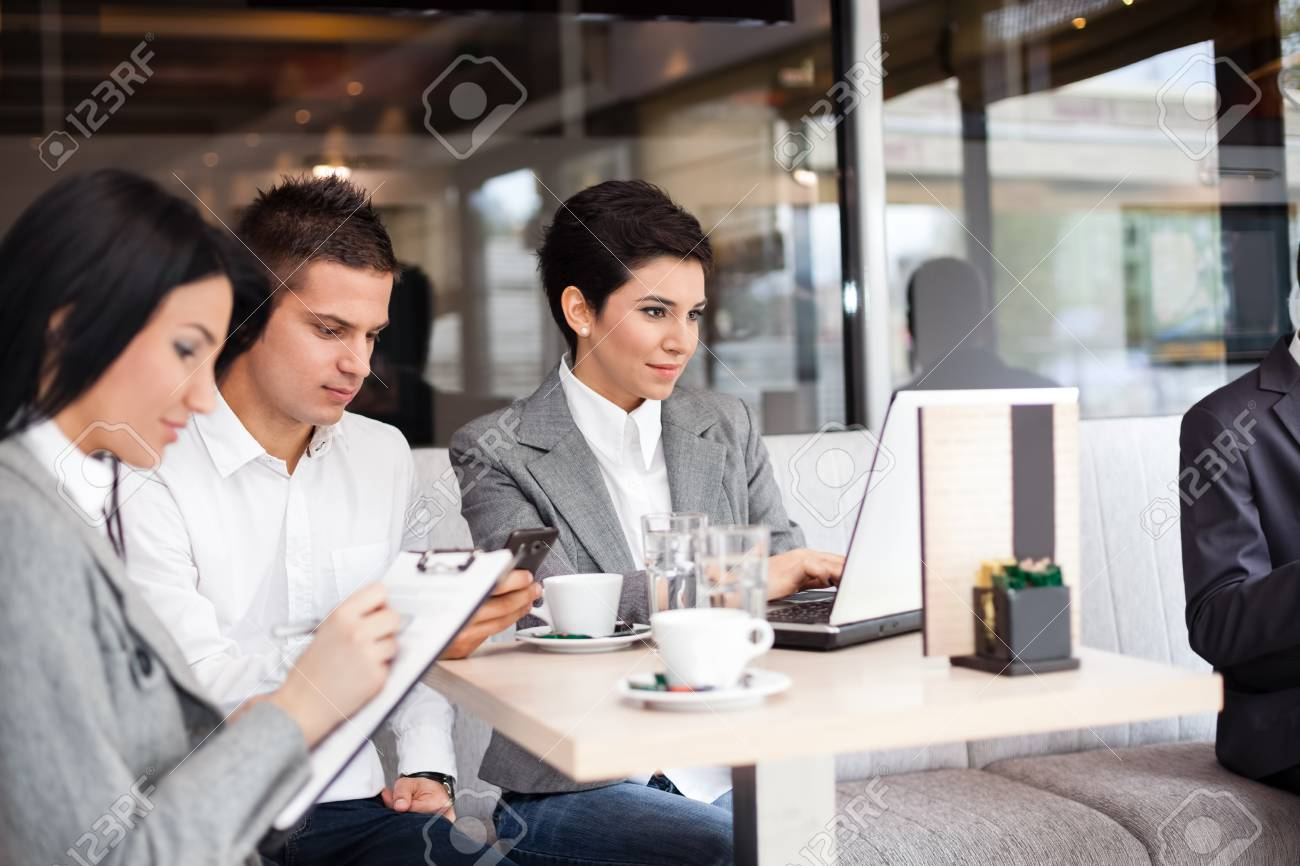 group of businesspeople having briefing in cafe Stock Photo - 19404684