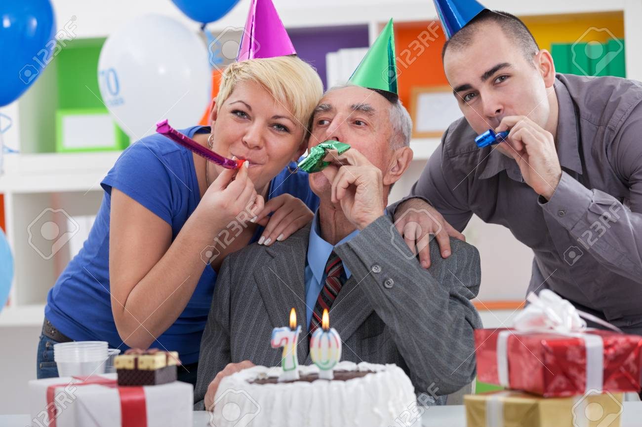 Happy Family Together Celebrating 70th Birthday Stock Photo