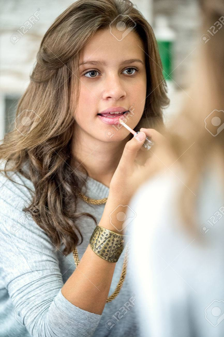 Beautiful Teenager Girl With Lip Gloss Front Of Mirror Stock Photo
