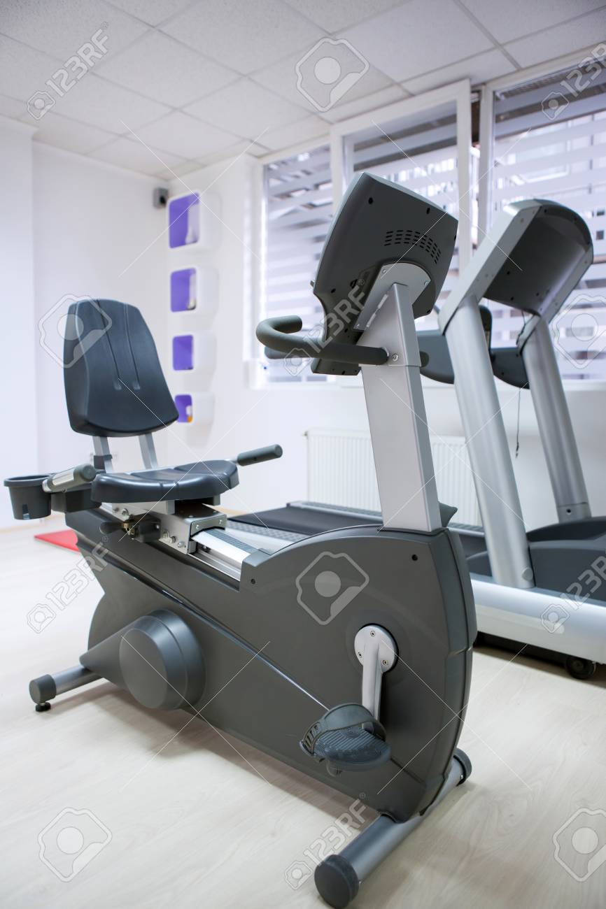 elliptical cross trainer, stationary bicycle at fitness gym Stock Photo - 26754253