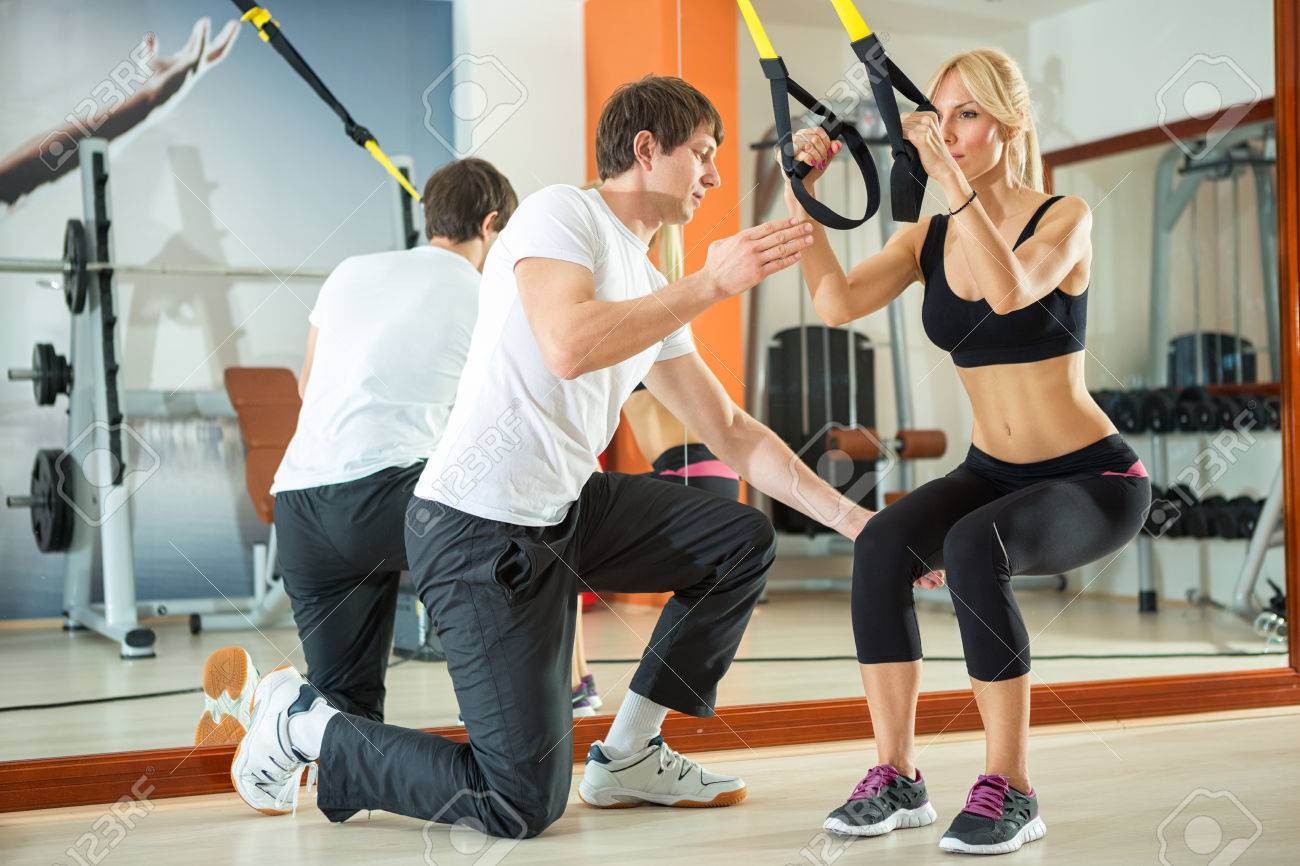 Woman Doing Workout With Fitness Straps