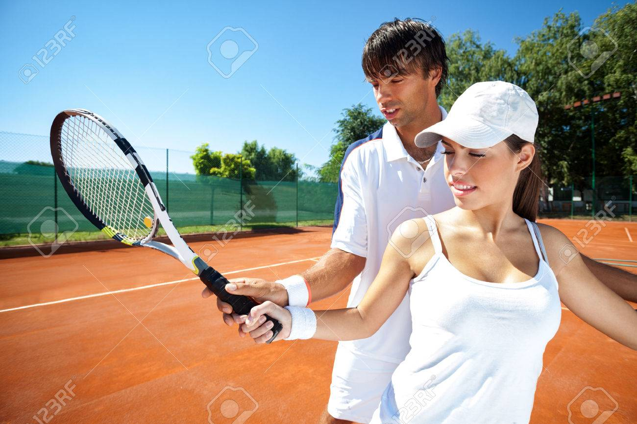 Woman And Male Tennis Instructor Practicing Racket Control On ...
