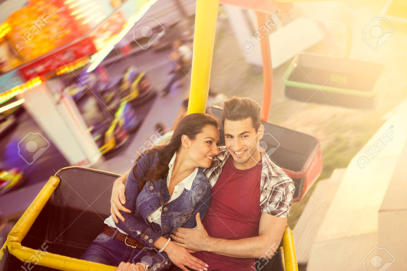 Young Smilinf Couple Having A Ride On A Ferris Wheel Stock Photo Picture And Royalty Free Image Image 29052930