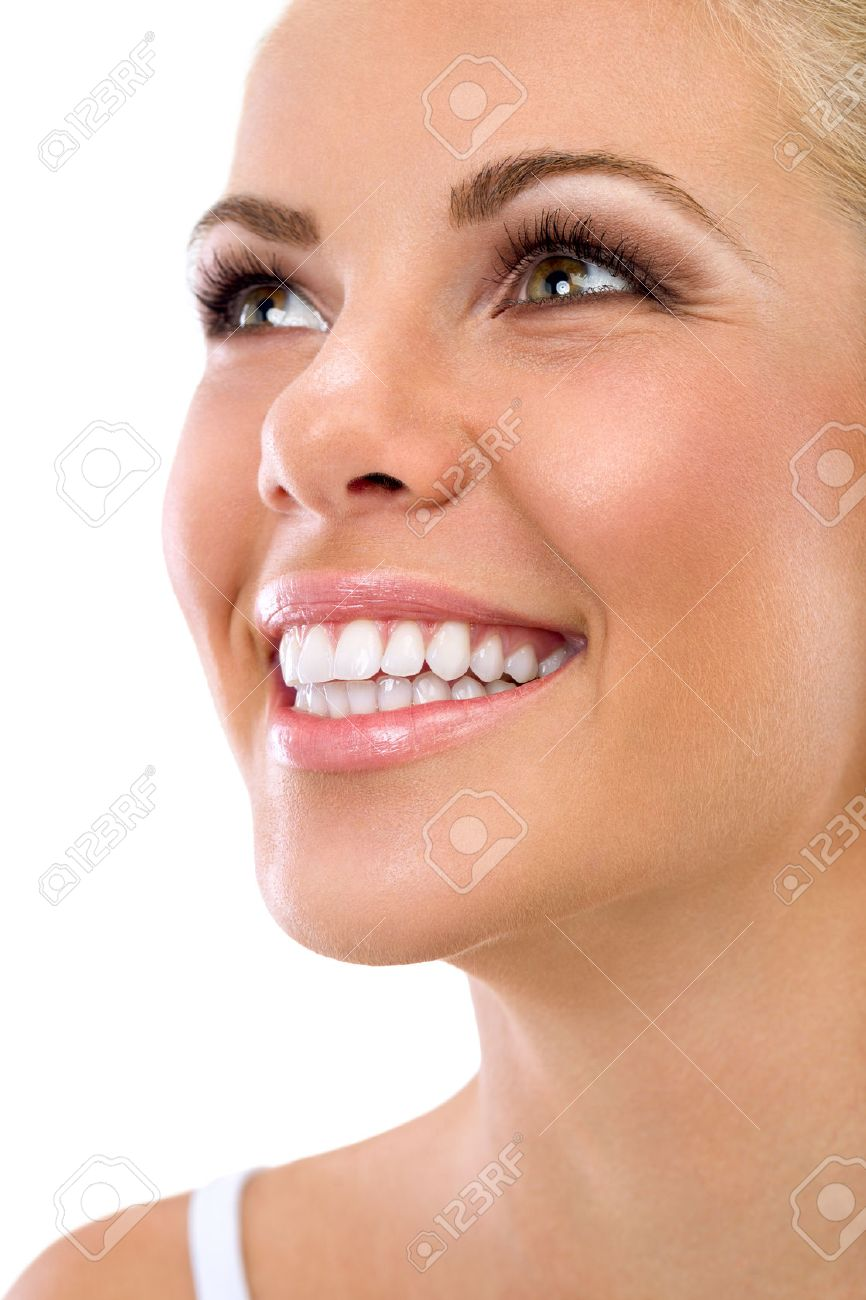 Beautiful smile of young woman with great healthy white teeth, isolated over white background - 31582001