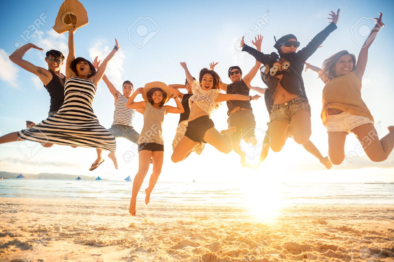 jumping at the beach, summer, holidays, vacation, happy people concept Stock Photo - 42200188