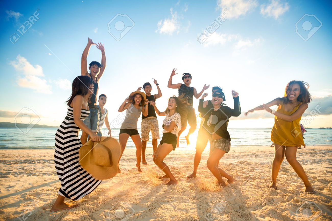 Happy young people on beach Stock Photo - 42200947
