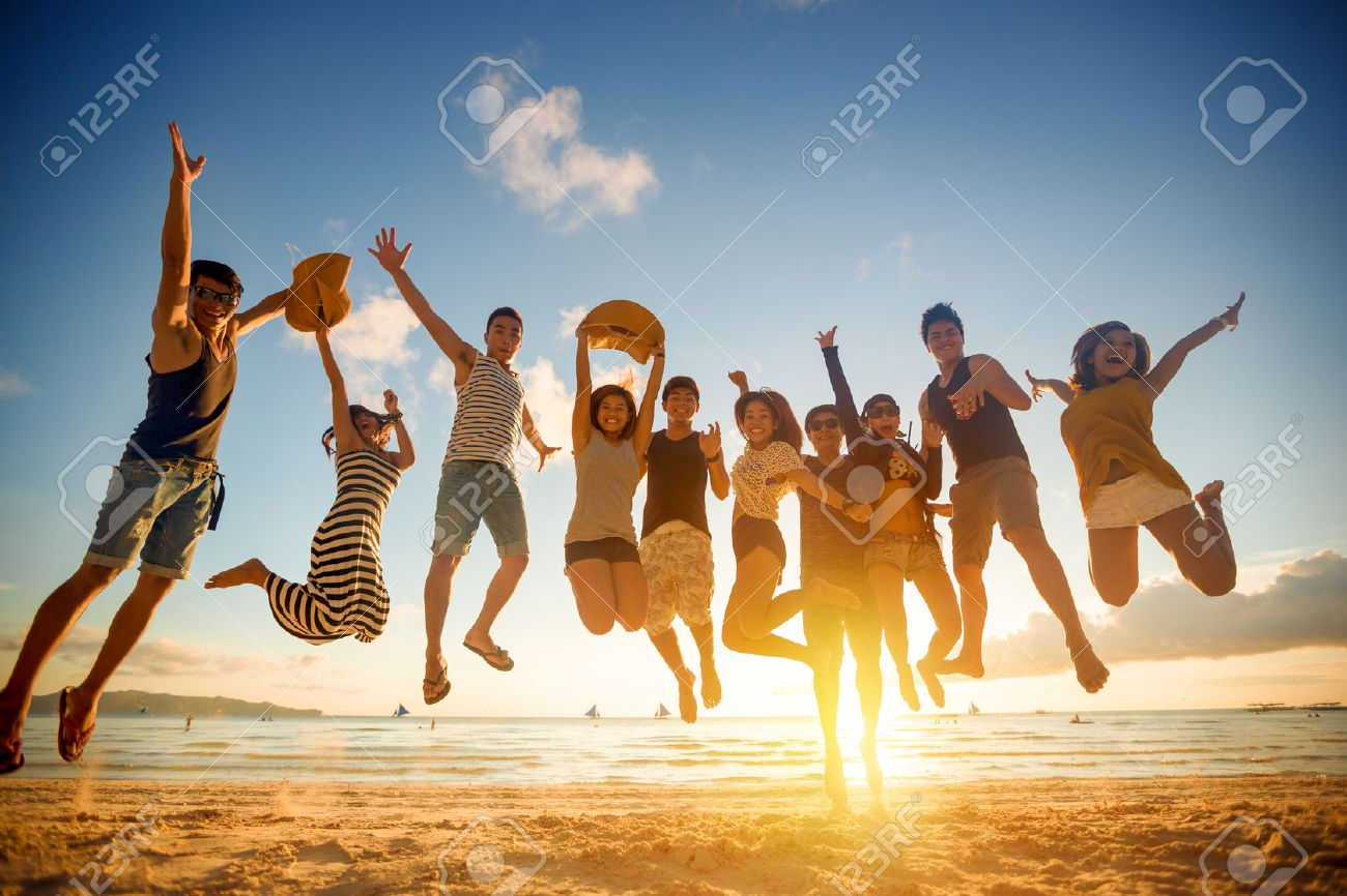 Group of young people jumping on beach Stock Photo - 42200967
