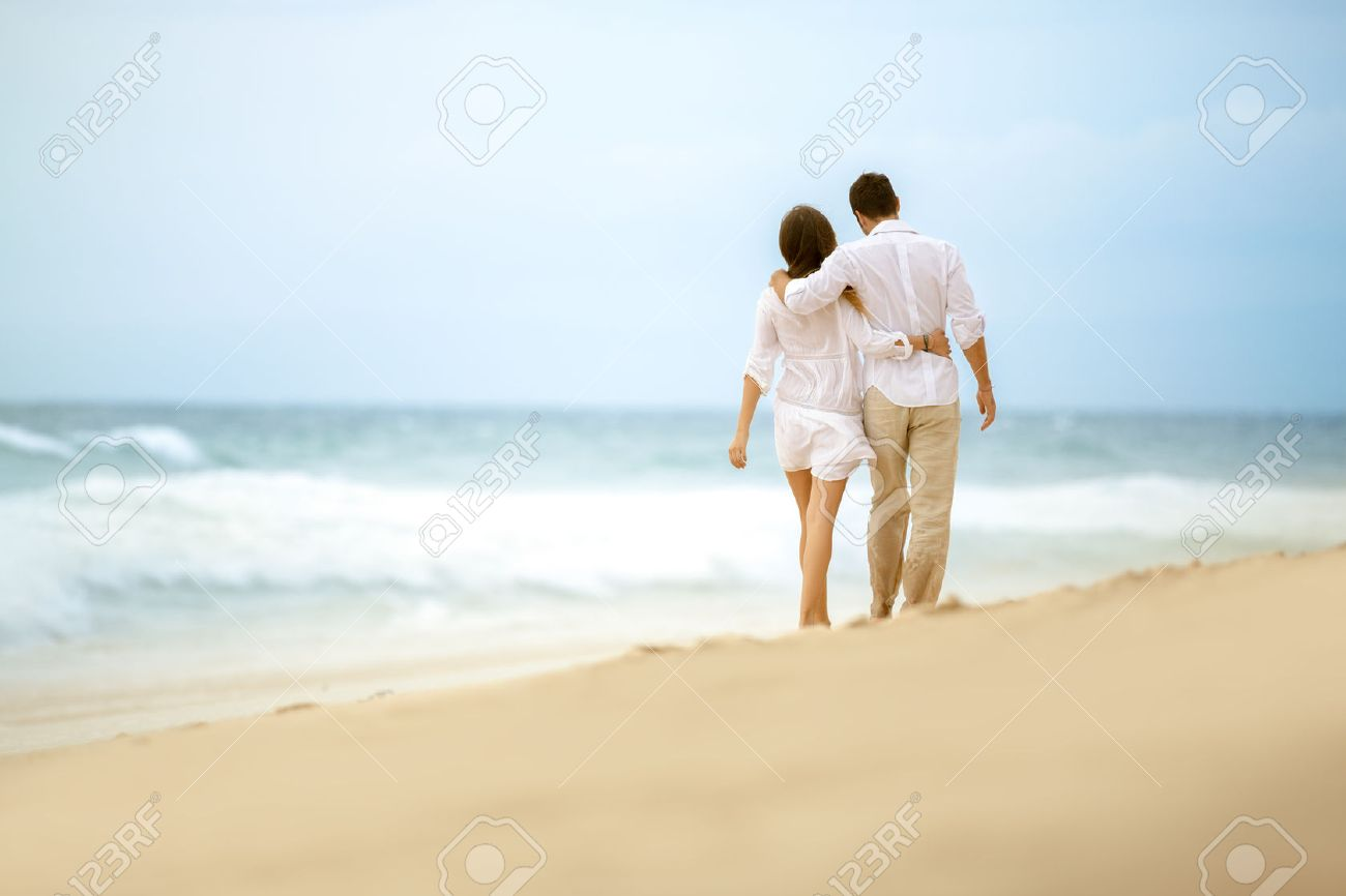 Couple Walking On Beach Embracing Love Couple