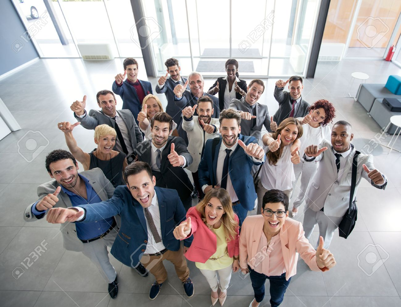 Portrait of thumb up smiling business people - 54231993