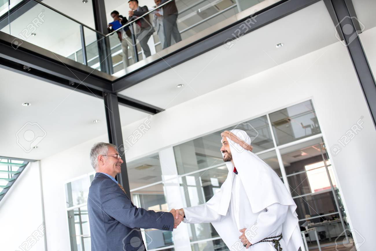 Director of global company receive Arabian businessman