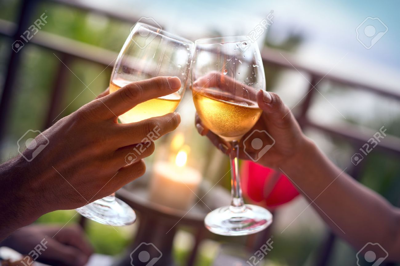 Hands of man and woman cheering with glasses of white wine - 51515149