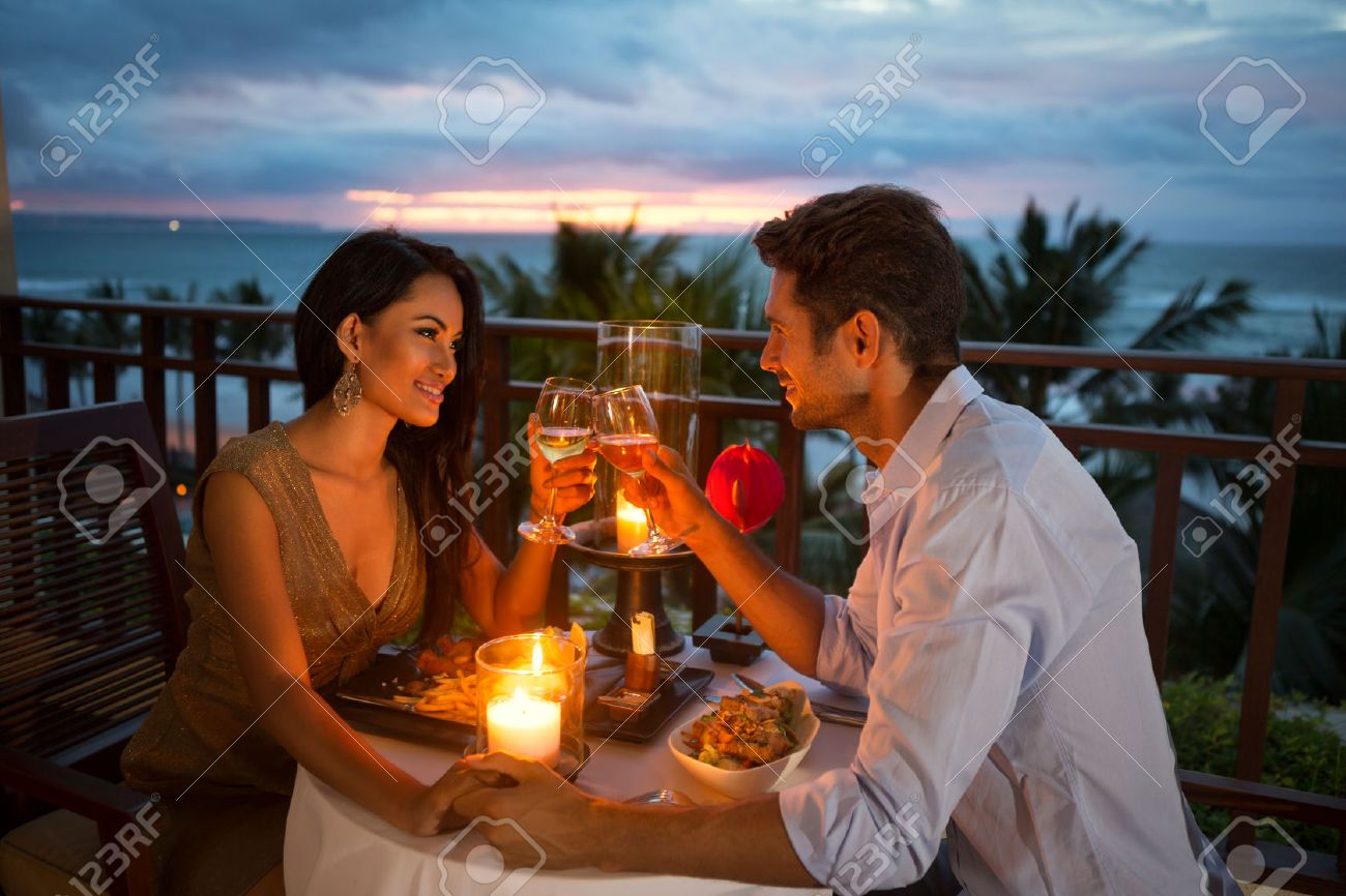 young couple enjoying a romantic dinner by candlelight, outdoor - 51516238