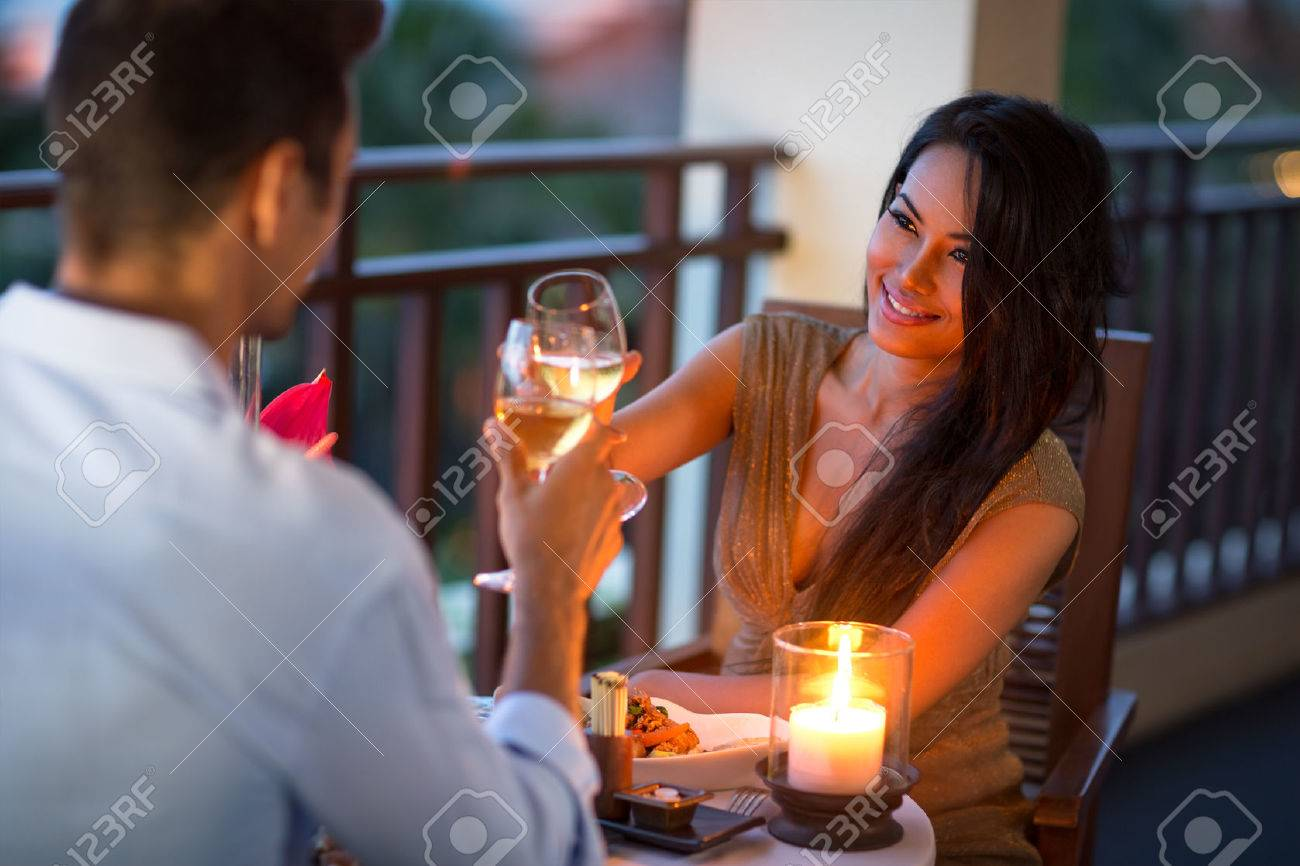 Couple having intimate dinner for two on the terrace of summer evening - 51516866