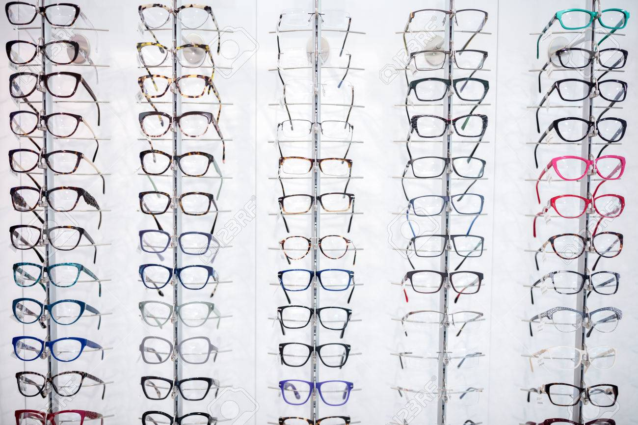 In eyewear shop can be seen large selection of frames for eyeglasses - 52138231