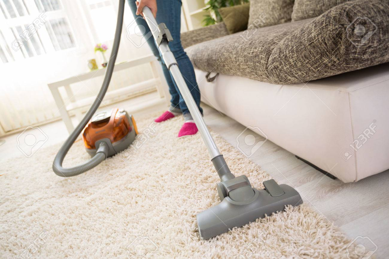 Cleaning Carpet With Vacuum Cleaner In Living Room Stock Photo ...