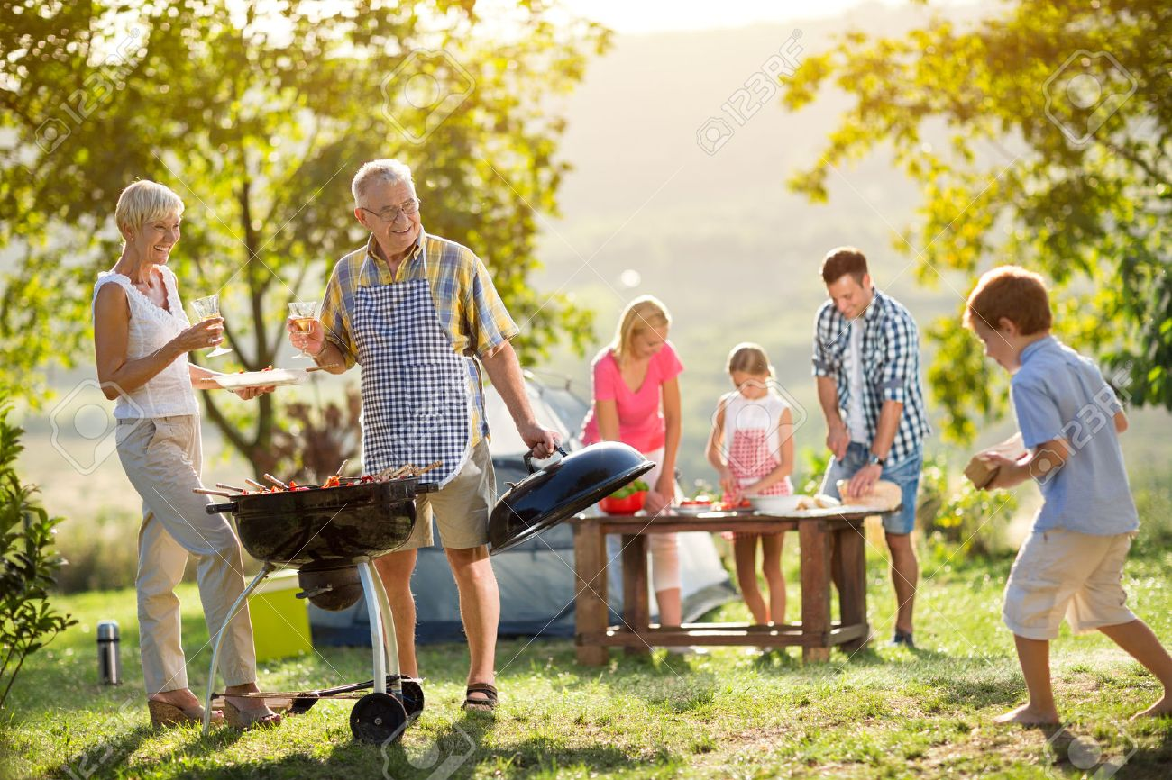 Happy family camping and cooking bbq - 55715789