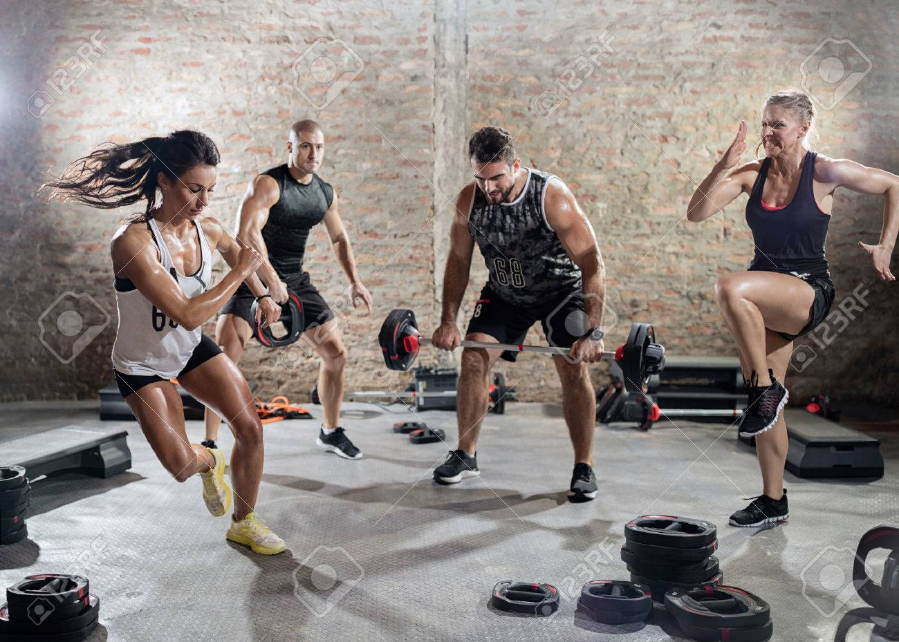 sporty people  practicing with weights, high intensity training Banque d'images - 56319647